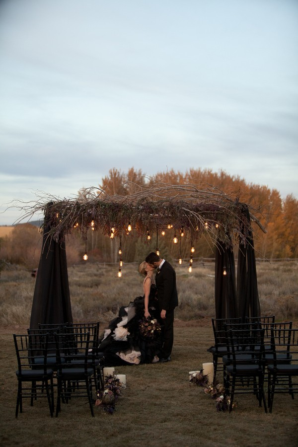 Black Wedding Altar with Rustic Branch Accents and Suspended Light Bulbs – featured on Trendy Bride