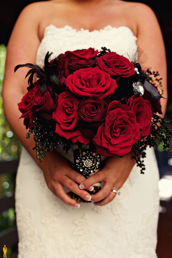 Gothic Wedding Bouquet with Red Roses and Black Feathers and Accents – shared on High Society Event Planning