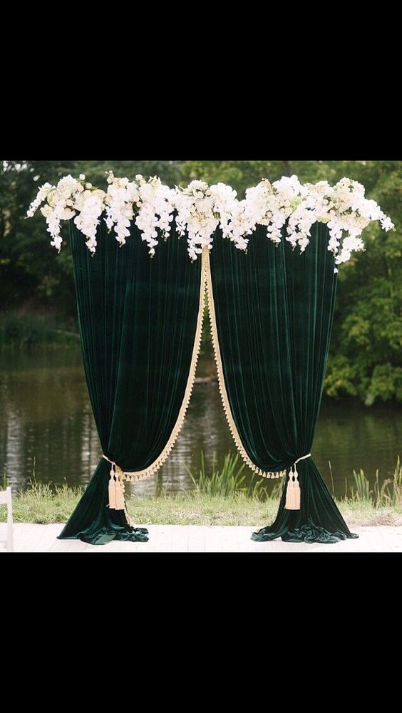 Draped Green Velvet Wedding Altar with Gold Tassels and White Orchid Border