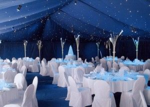 Dark Blue Tent Ceiling with White Seating and Tables – shared in a roundup by Bodas and Weddings
