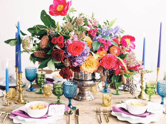 Bold and Colorful Bohemian Table Centerpiece and Settings – featured on Green Wedding Shoes