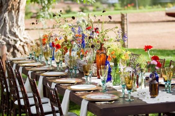 Vintage Glass and Wildflower Bohemian Estate Table Decoration and Settings – featured on Style Me Pretty