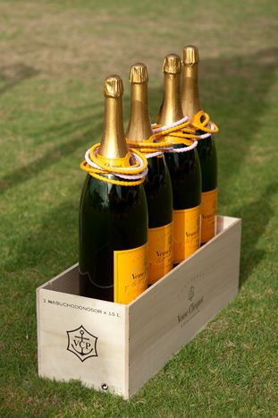 Oversized Champagne Bottle Ring Toss Game – shared on BizBash