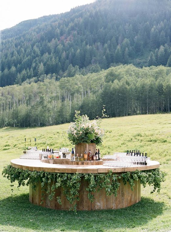 Round Wooden Barrel Bar with Vine Accents – shared by Easton Events