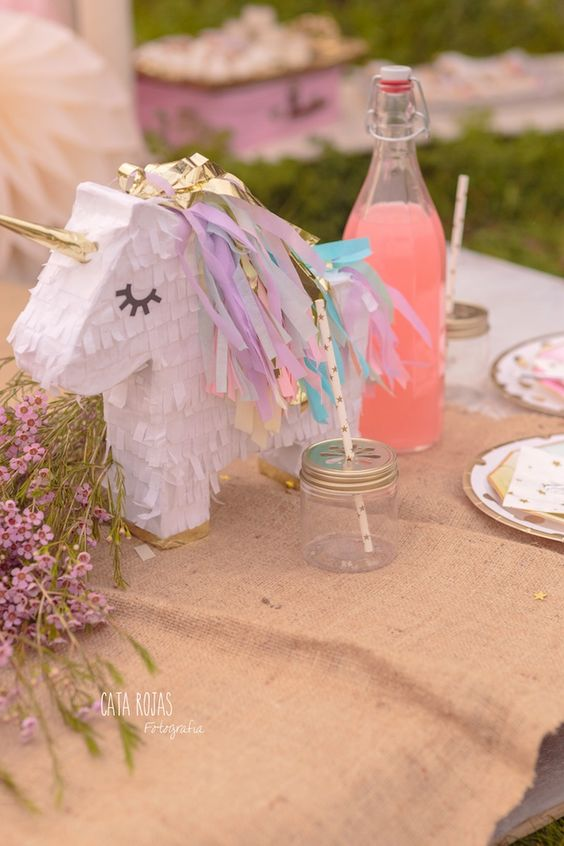 Unicorn Pinata Table Centerpiece – shared on Kara's Party Ideas