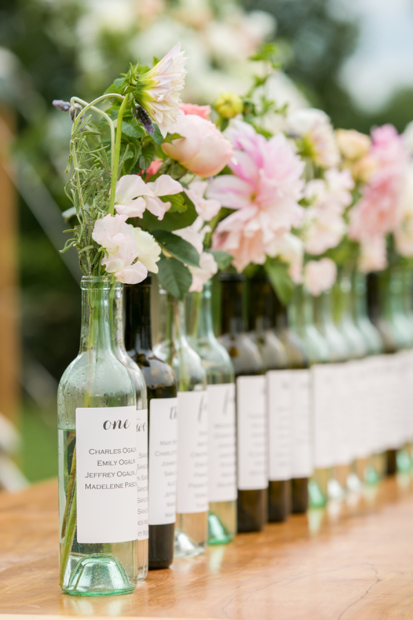 Wine Bottle Seating Charts with Spring Flowers – shared by Melani Lust Photography in the Style Me Pretty Vault