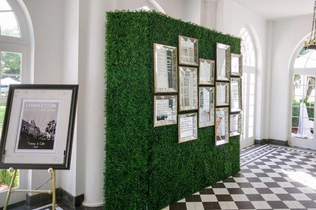 Boxwood Wall Hedge with Mirror Seating Charts – captured by Dana Cubbage Weddings and shared on Borrowed and Blue