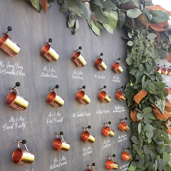 Copper Cups Display with Greenery Border