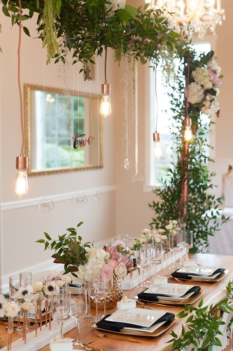 Copper Trellis with Greenery and Edison Bulbs Tablescape – shared on Inside Weddings