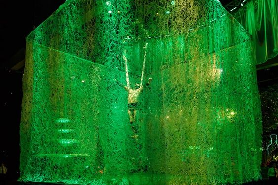 Green Draped and Illuminated Entertainment Cube – shared in a roundup post by BizBash