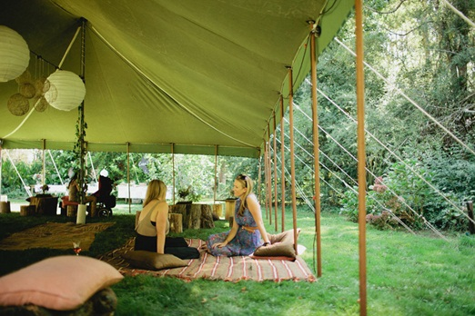 Green Event Tent with Picnic Seating – shared by The Natural Wedding Company