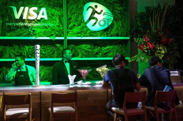 Green Fern Bar with Green Lighting – shared in a roundup by BizBash