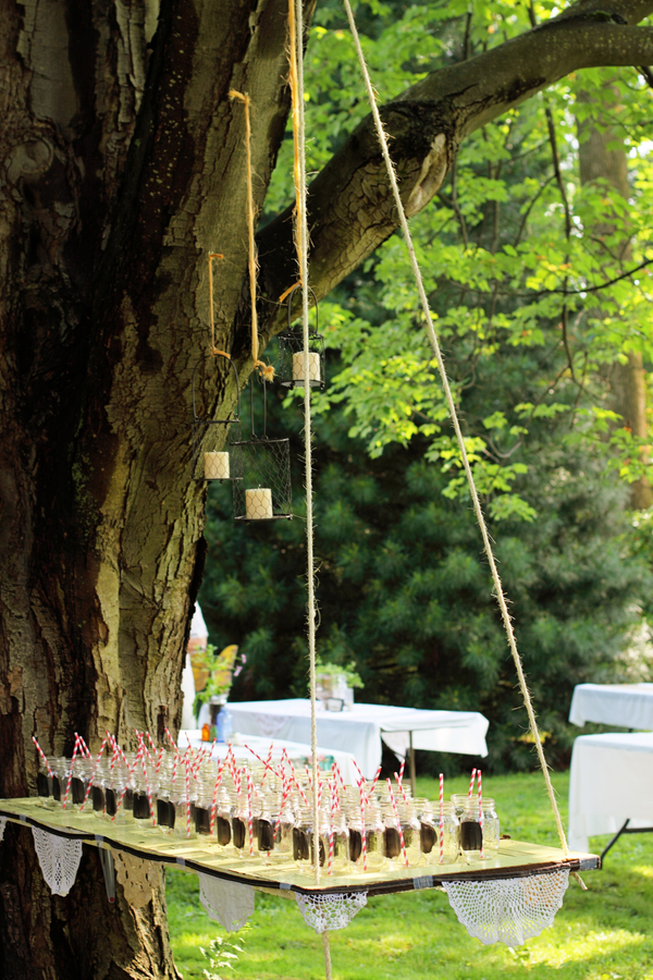 Hanging Mason Jar Display for Guest Drinks – shared on Capitol Romance