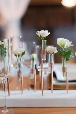 Industrial Centerpiece of Glass Tubes and Copper – also shared on Inside Weddings