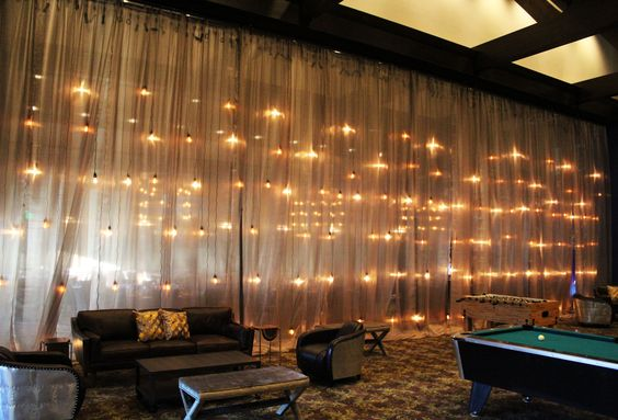 Industrial Edison Bulb Wall with Metallic Draping – shared by In The Event