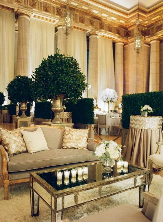 Mirror and Neutral Lounge with Topiary Accents and Boxwood Room Dividers
