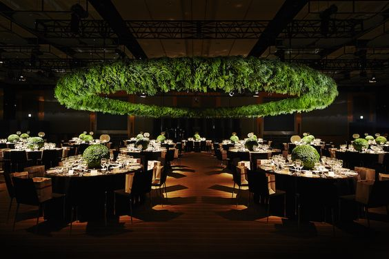 Oversized Green Foliage Ring Suspended Above the Dancefloor – shared on Azumamakoto