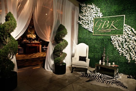 Twisted Topiary and Boxwood Entrance Wall – shared in a roundup post by BizBash