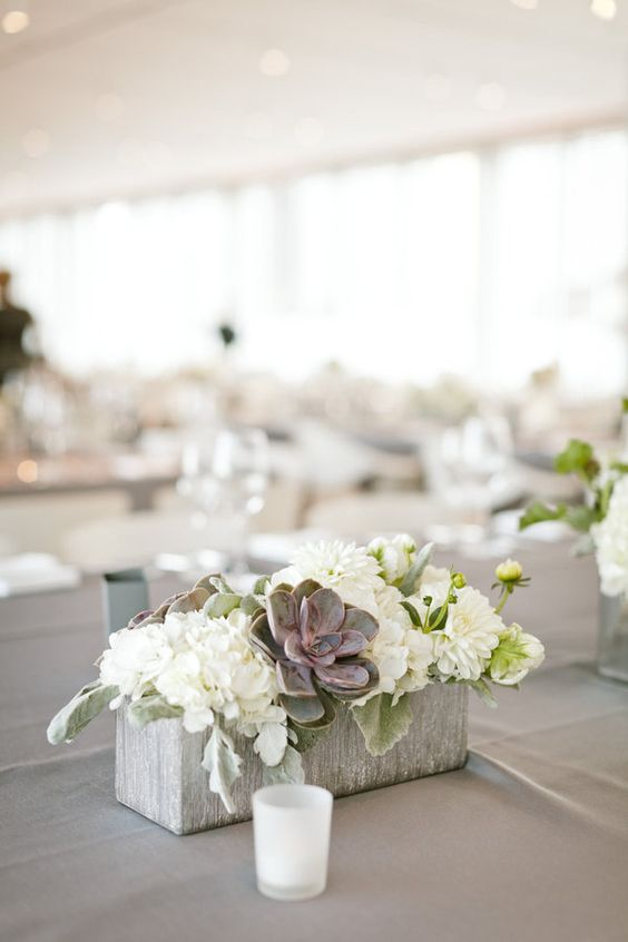 Concrete Block Centerpiece with White Flowers and Succulents – shared on Style Me Pretty