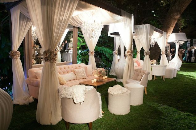 Draped White Lounge Cabanas on the Lawn with Blush Furniture and Crystal Chandeliers – shared by Revelry Events
