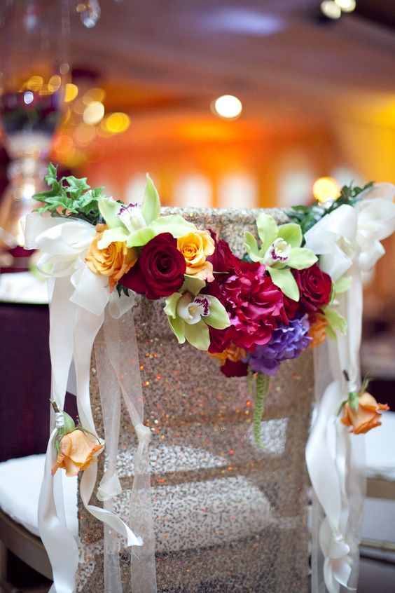 Chivari Chair with Sequin Cover and Colorful Wildflower Swag