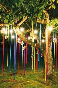 Colorful Outdoor Ribbons in a Tree with String Lights – shared in a roundup post by Decozilla