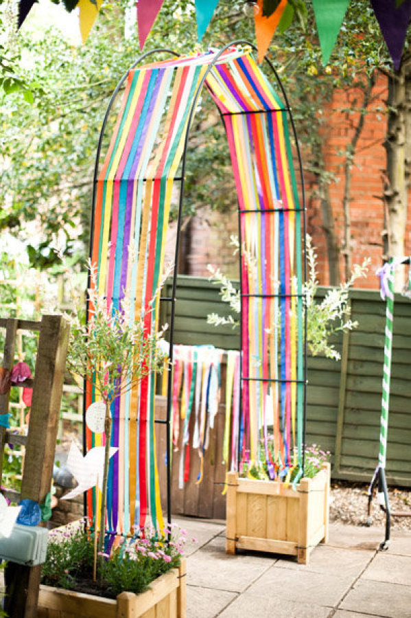 Rainbow Streamer Decorated Arch Entrance – shared in the Style Me Pretty Vault