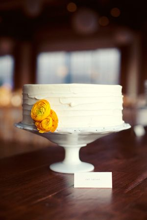 Single Tier White Textured Cake with Yellow Ranunculus Flower – created by Sugar Bee Sweets Bakery
