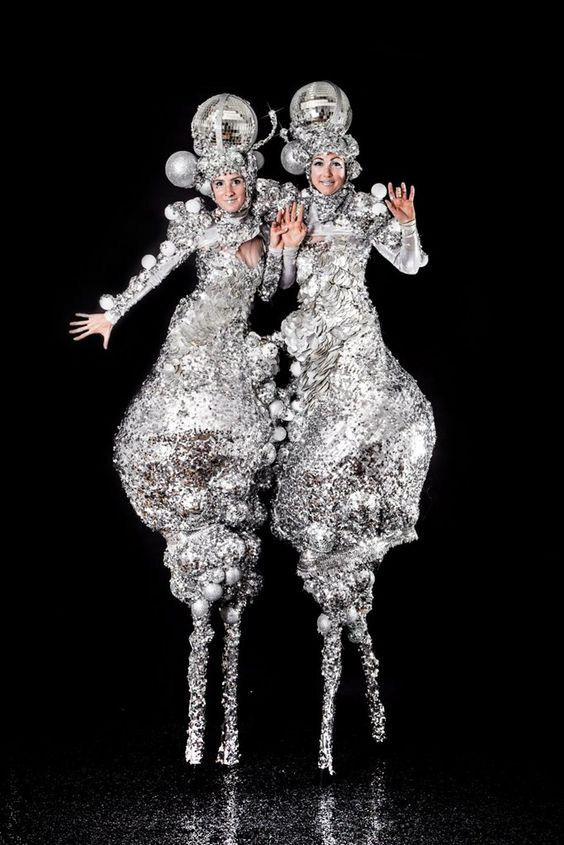 The Silver Belles Stilt Walkers with Disco Balls Event Entertainment – featured on Contraband