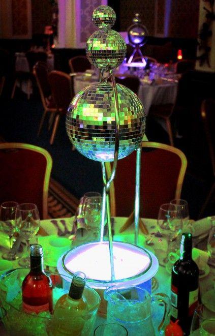Tiered disco ball centerpiece unique pastiche events for Decoration annee 80