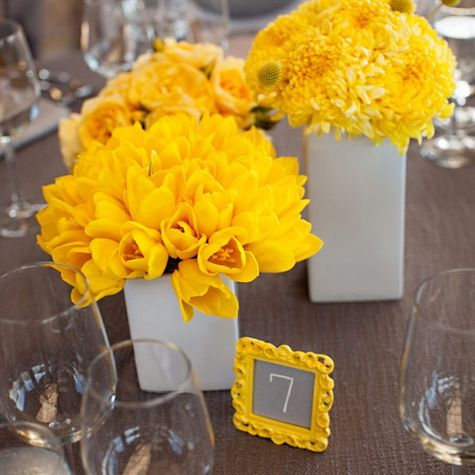 White Square Vases with Yellow Flower Arrangements – also shared on The Knot