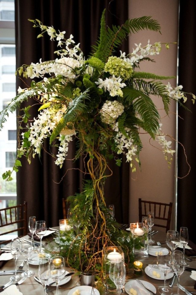 Lush Tall Garden Centerpiece with Green Foliage and White Flowers – shared on Style Me Pretty