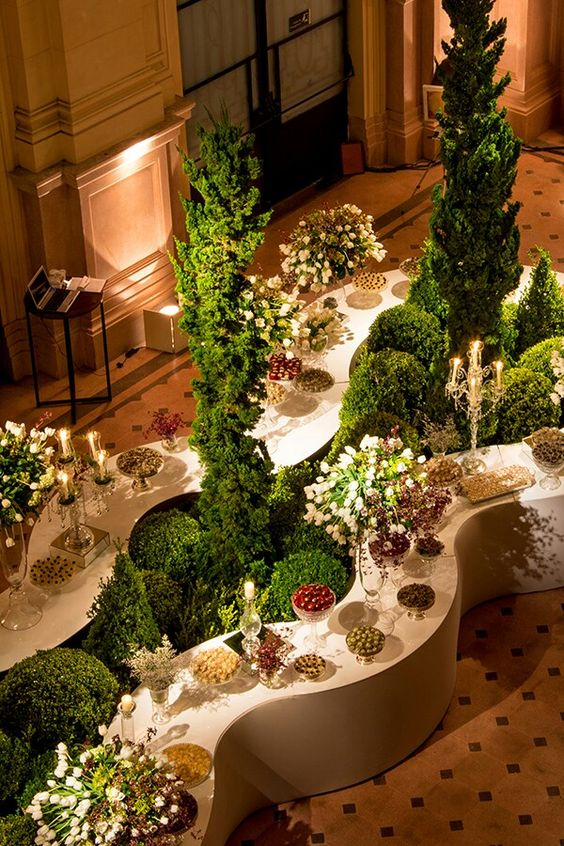White and Green Food Buffett and Dessert Display with Wave Bars, Topiary Bushes, and Green Foliage