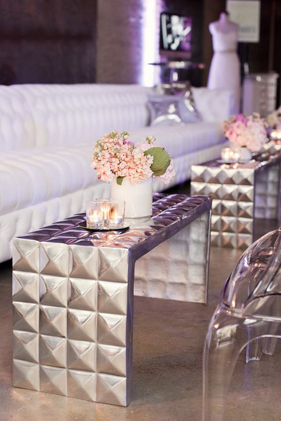 White and Silver Lounge with Silver Stud Metal Accent Tables – featured on LuxeFinds