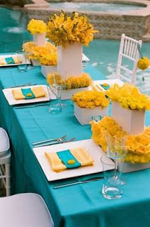 Yellow and White Centerpieces on Turquoise Tablescape – spotted on Pinterest
